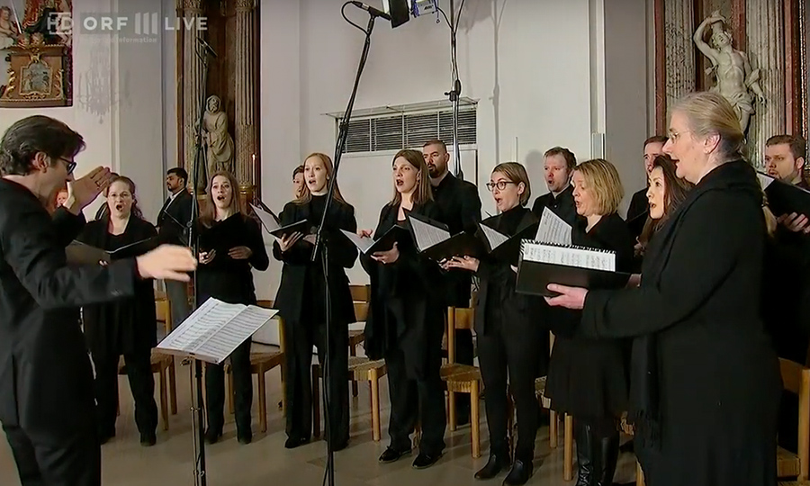 A photograph of the Vocal Ensemble singing.